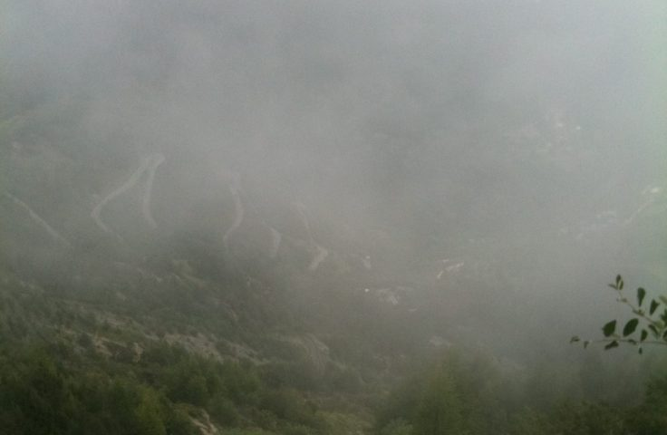 Wreathed in mist: looking down on the bends from an alpine trail
